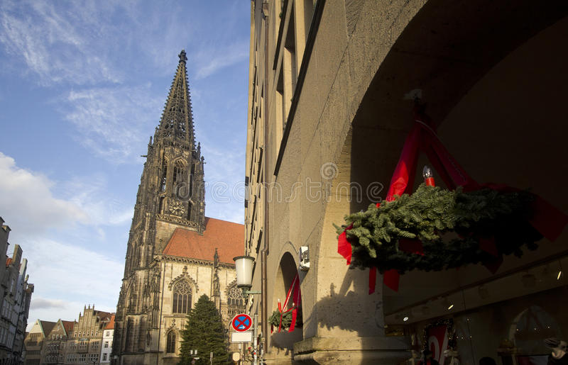 Christmas wreath in Munster, Germany. Christmas wreaths outside shops and a christmas tree in front of Saint Lamberti Church in Munster, Germany stock photo