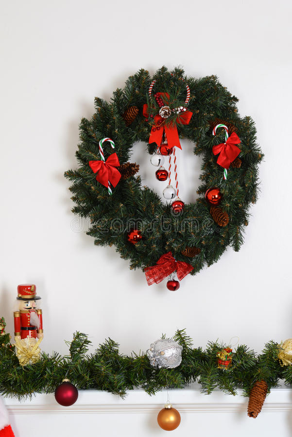 Christmas wreath over fireplace mantel. And garland stock photography