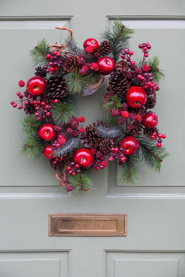 Download Christmas Wreath On A Pale Green Door Stock Photo - Image of cones, letterbox: 33509228