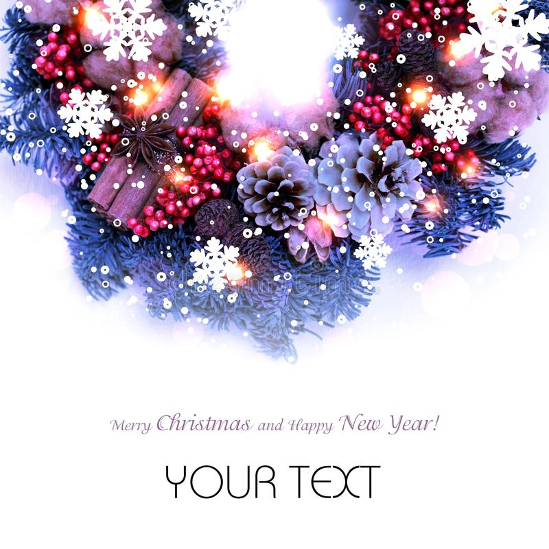 Christmas wreath in purple shades with snowflakes isolated. Beautiful Christmas wreath on a white background decorated with snowflakes and lights. There is a royalty free stock photography