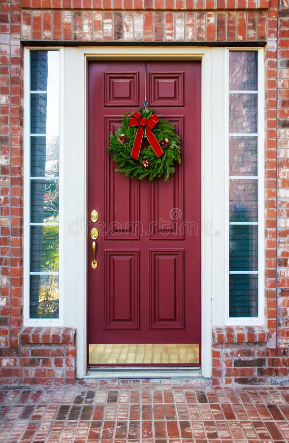 christmas wreath on a red door stock photo image of holiday leaves 35559796. Black Bedroom Furniture Sets. Home Design Ideas