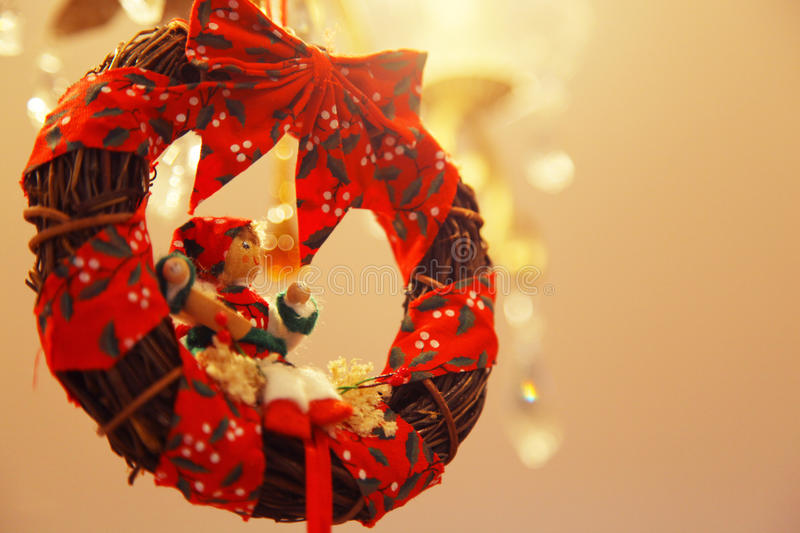 Christmas wreath with small woman figure royalty free stock images