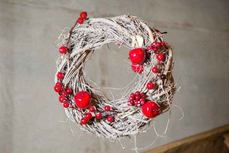 Christmas wreath of twigs, decorated with apples and berries of mountain ash.  stock image