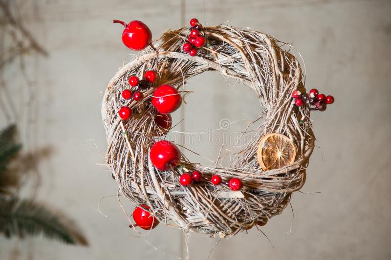 Christmas wreath of twigs, decorated with apples and berries of mountain ash.  royalty free stock image