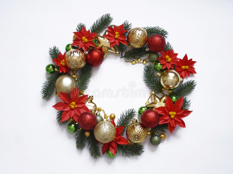 Christmas wreath on white background, banner with fir branches and balls. View from above. Colors are gold, red, green and white. stock images