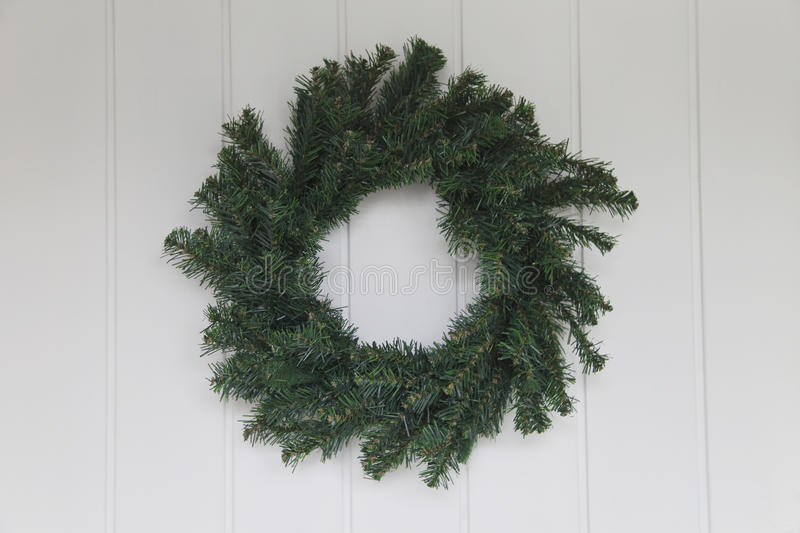 Christmas Wreath on White Front Door stock photo