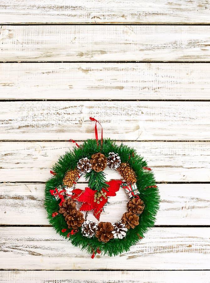 Christmas wreath decoration hangs on front door vertical frame stock photos