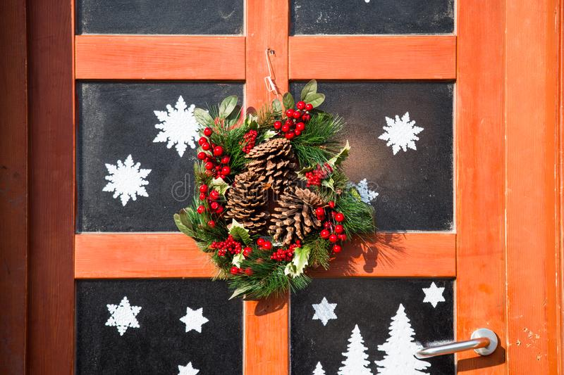 Christmas wreath, wooden door with glass, Christmas decoration, royalty free stock photos