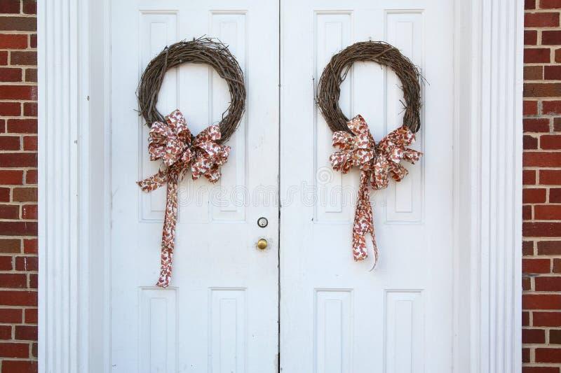 Christmas wreaths on doors royalty free stock photo