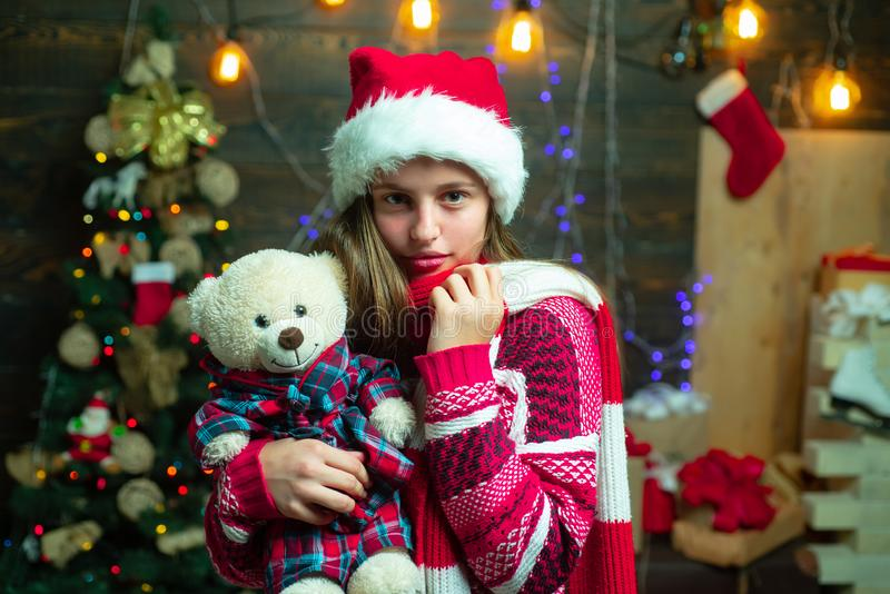 Christmas Xmas winter holiday concept. The morning before Xmas. Teenager Christmas. Merry Christmas and Happy New year. Portrait kid with gift on wooden stock photography