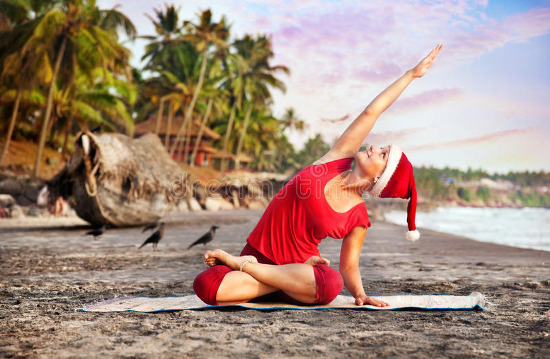Christmas yoga on the beach stock photos