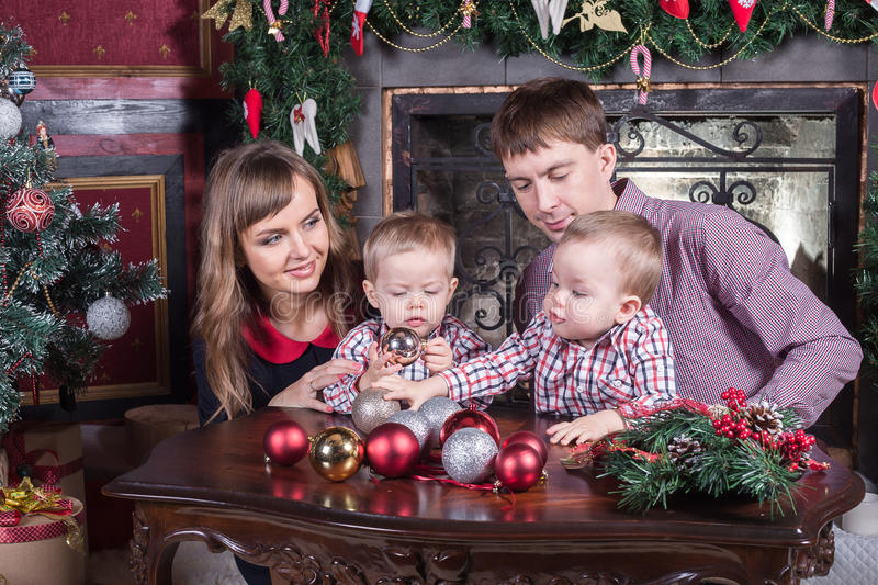 Christmas Young family. Christmas. Young family has a rest. The room is festively decorated royalty free stock photos