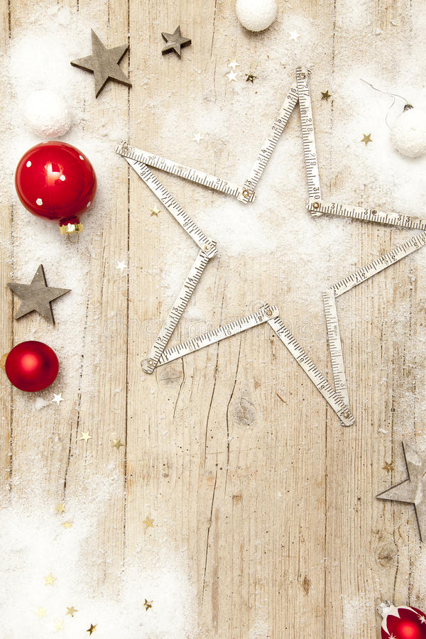Christmassy grey wood background with decoration stock photo