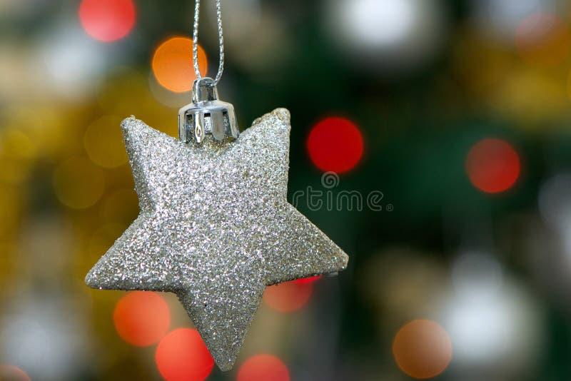 Christmast树的闪烁的星装饰品 图库摄影