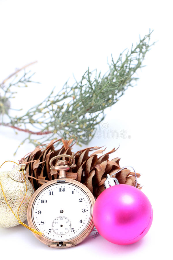 Christmastime with vintage clock baubles and cone. Picture of a Christmastime with vintage clock, baubles and cone stock photos