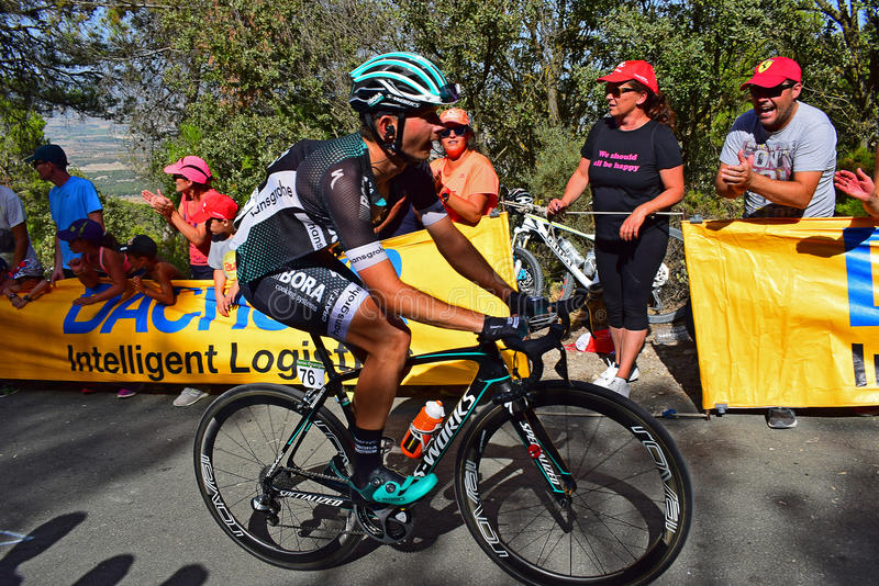 Christoph Pfingsten Cheered On By The Crowd La Vuelta España Cycle Race. The crowd applauding the Team Bora rider near the mountain top finish in the 2017 La stock images