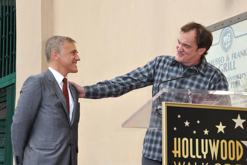 Christoph Waltz & Quentin Tarantino. LOS ANGELES, CA - DECEMBER 1, 2014: Christoph Waltz with Quentin Tarantino at Hollywood Walk of Fame ceremony honoring stock image