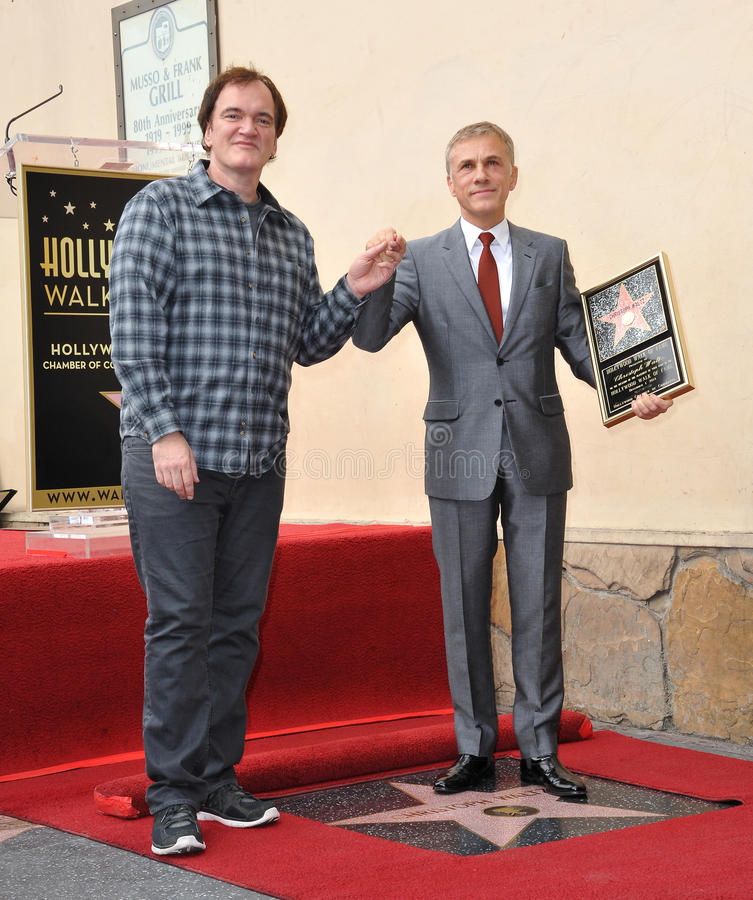 Christoph Waltz & Quentin Tarantino. LOS ANGELES, CA - DECEMBER 1, 2014: Christoph Waltz with Quentin Tarantino at Hollywood Walk of Fame ceremony honoring stock photo