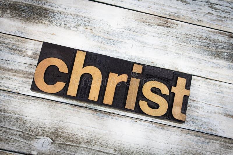 Christus-Briefbeschwerer-Wort auf hölzernem Hintergrund lizenzfreie stockfotos