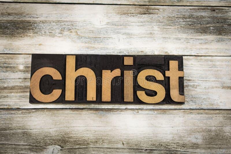 Christus-Briefbeschwerer-Wort auf hölzernem Hintergrund lizenzfreie stockfotografie