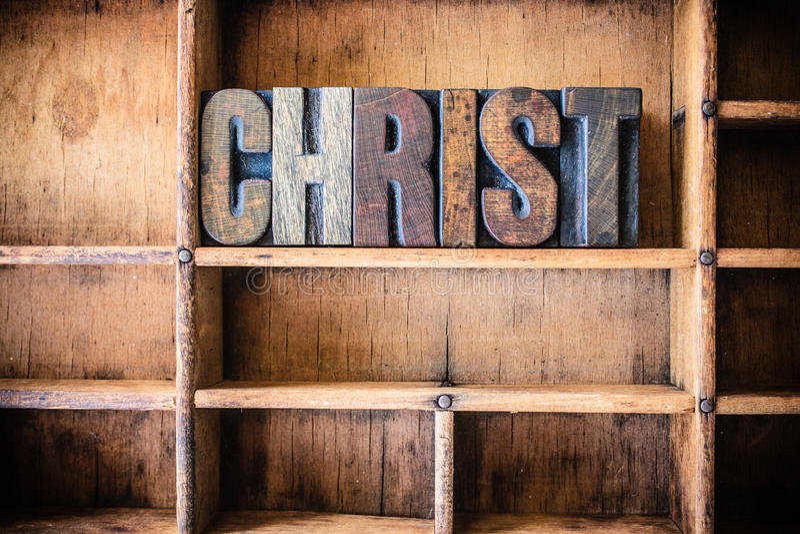 Christus-Konzept-hölzernes Briefbeschwerer-Thema stockfotos