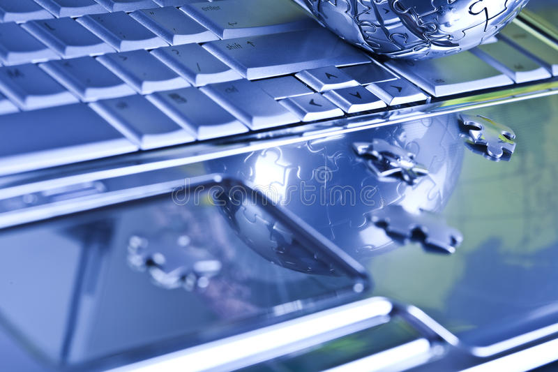 Chrome. Notebook & puzzle earth chrome globe stock images