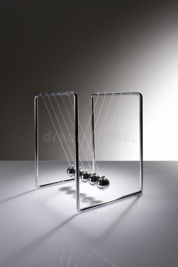 Chrome balancing spheres know as Newton's Cradle stock photography