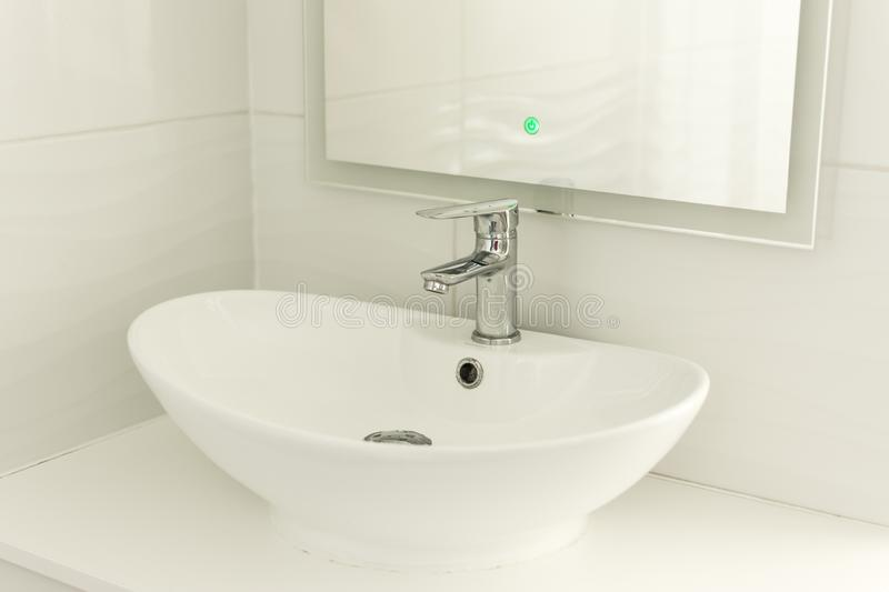 Chrome faucet, sink and washbasin royalty free stock photos