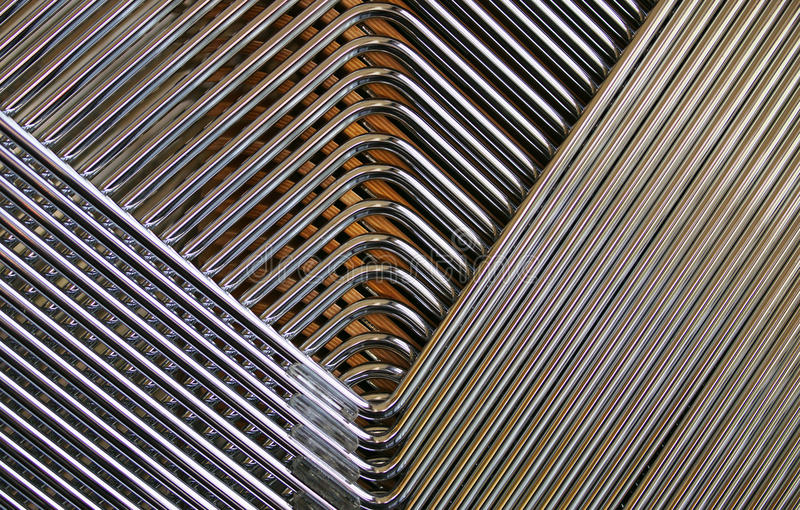 Chrome lines. A background of chrome lines from stacked chairs royalty free stock image