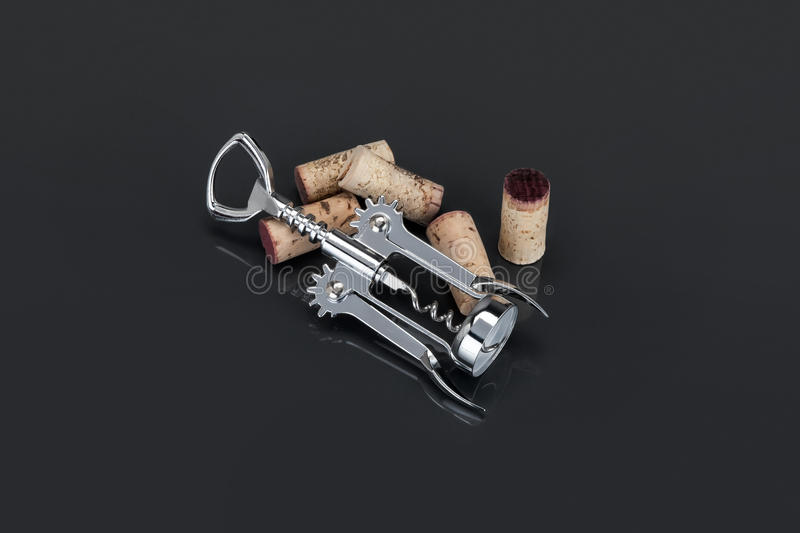 chrome metal corkscrew and corks royalty free stock photography