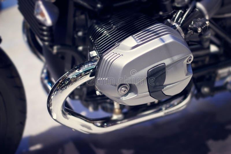 Chrome modern motorcycle engine close-up. Chrome modern motorcycle engine details stock image