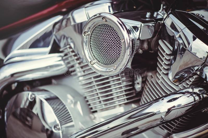 Chrome motorcycle air filter. And the engine, mild toning royalty free stock photo