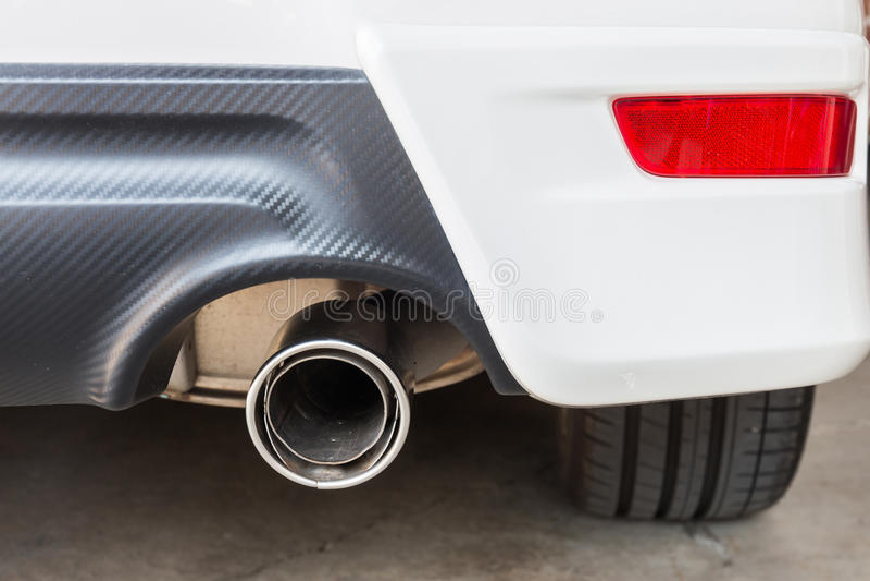 Chrome pipe of white powerful sport car stock photos