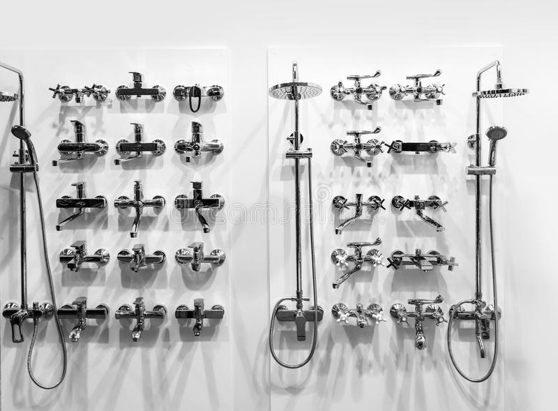 Chrome showers and faucets in plumbing shop stock image