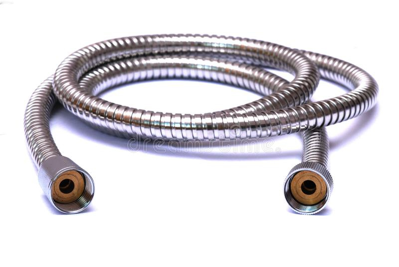 A chrome stainless steel flexible shower hose stock image