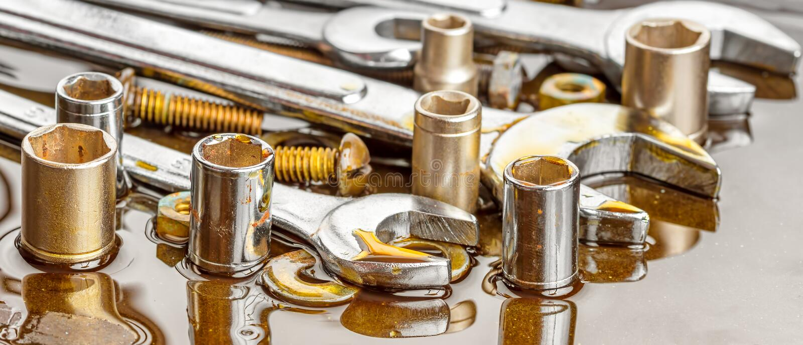 Chrome tools wrenches with grease stains stock photo