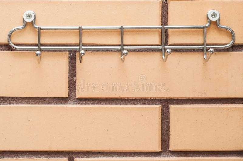 Chrome towel rack on a brick wall in the bathroom.  royalty free stock photos