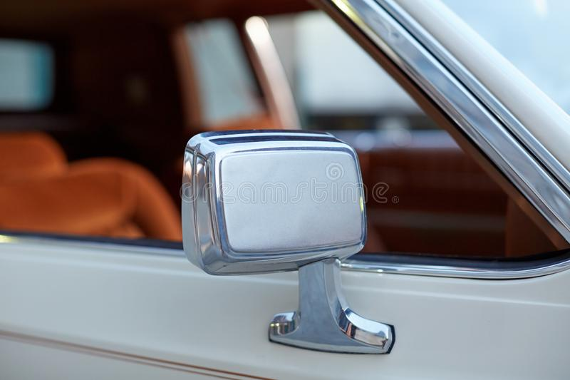 Chrome wing mirror on a classic vintage car stock photos
