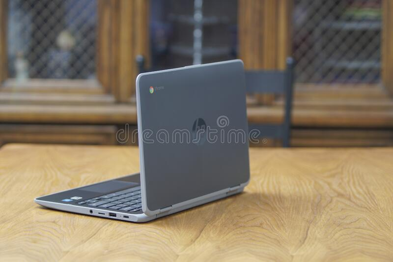 A Chromebook being posed to show its iconic chrome logo royalty free stock photo