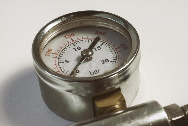 Chromed gauge high air gas pressure sensor meter close-up white background stock photo