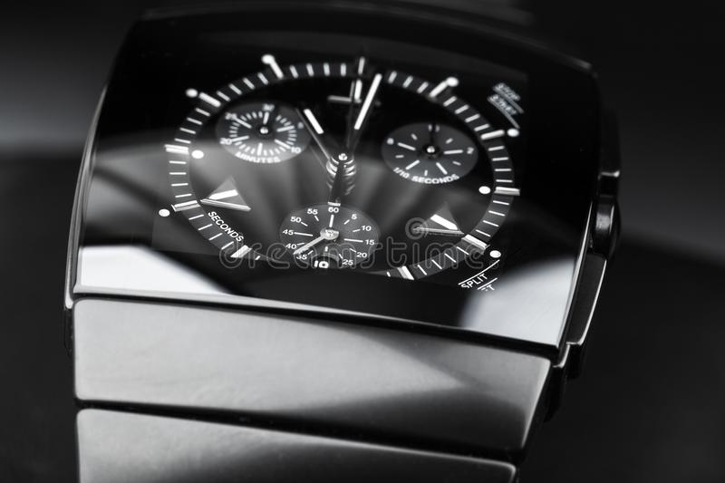 Chronograph, black wrist watch. Chronograph, wrist watch made of black high-tech ceramics. Close-up studio photo with selective focus stock image