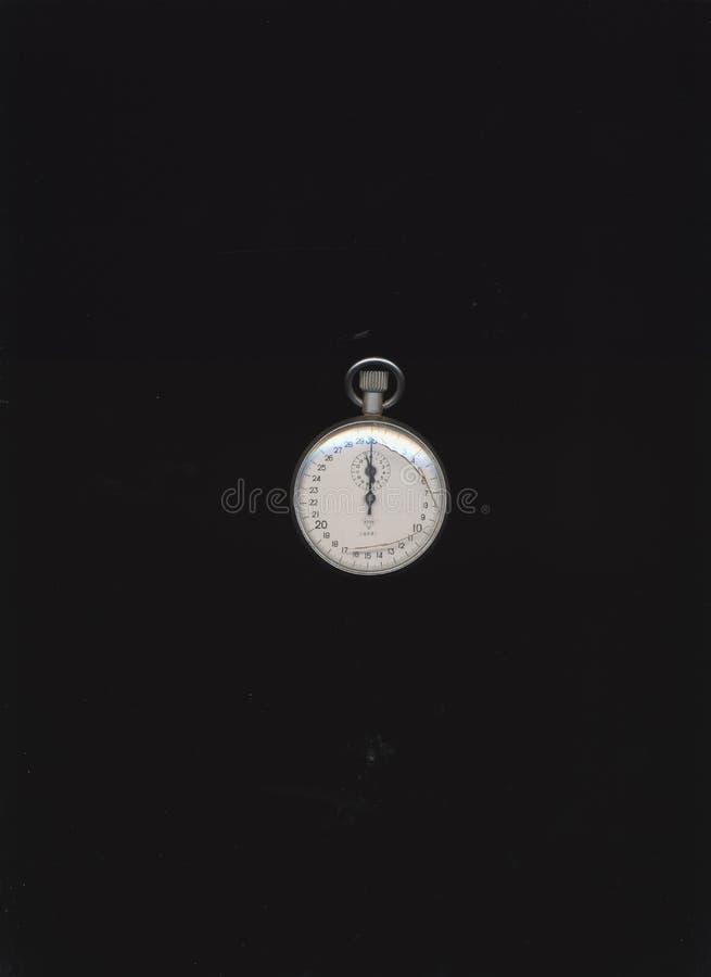 Chronomètre mécanique sur le fond noir photos libres de droits