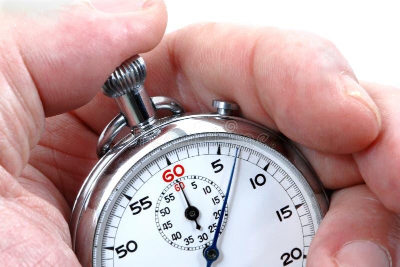 Chronometer in een hand stock fotografie