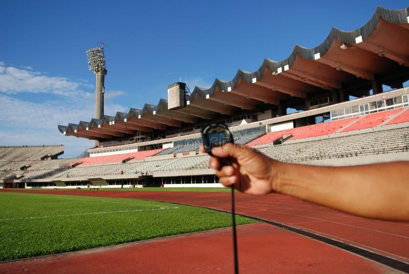 Chronometer en stadion stock foto's