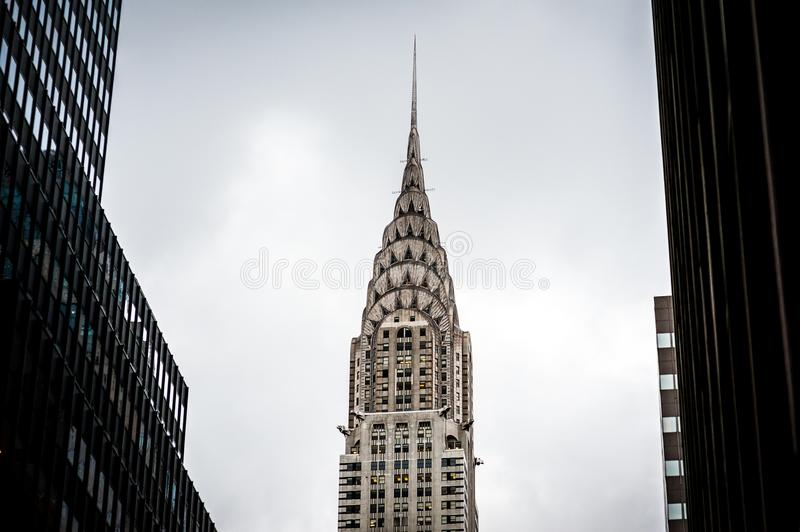 Chrysler Building surrounded by skyscrapers in New York. USA 2012. Peak of Chrysler building surrounded by two another skyscrapers in New York. USA 2012, June stock photography