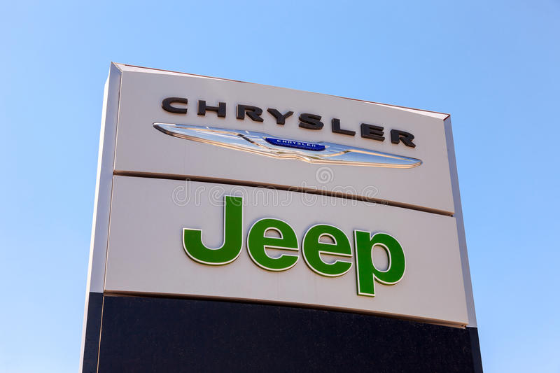 Chrysler, Jeep automobile dealership sign. All are part of the Chrysler Motor Company an American automobile manufacture royalty free stock image