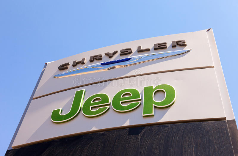 Chrysler, Jeep automobile dealership sign. SAMARA, RUSSIA - MAY 24, 2014: Chrysler, Jeep automobile dealership sign. All are part of the Chrysler Motor Company royalty free stock image