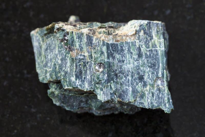 chrysotile asbestos stone on dark background royalty free stock photo