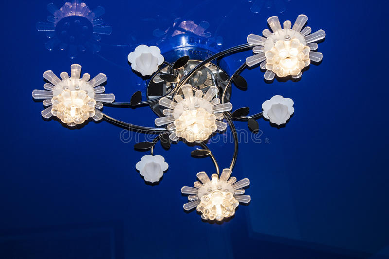 Chrystal chandelier close-up. blue light stock photography