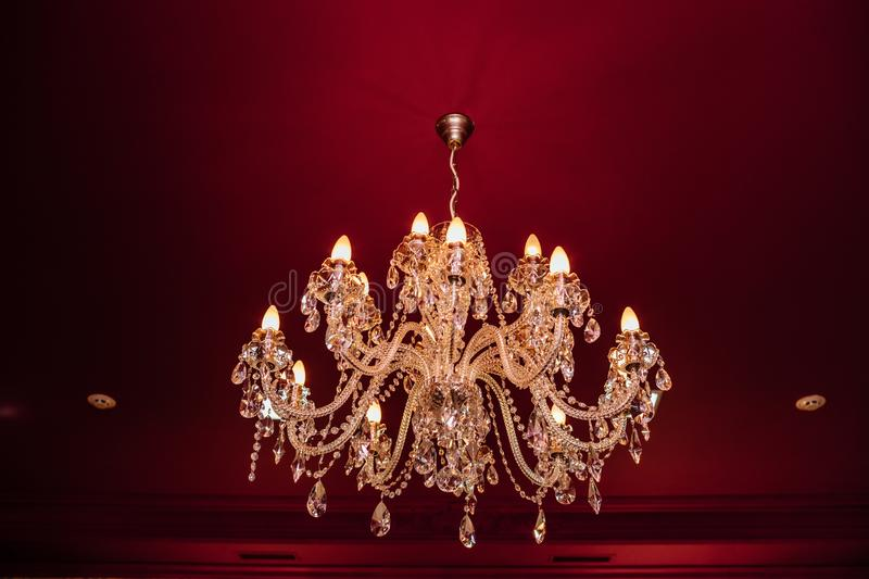 Chrystal chandelier close-up. In light background royalty free stock photo